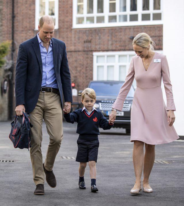 Prince George holding hands with the Duke of Cambridge and Helen Haslem