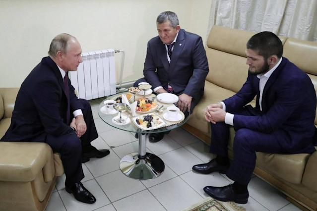 President Vladimir Putin met with Khabib Nurmagomedov and his father Abdulmanap (Reuters)