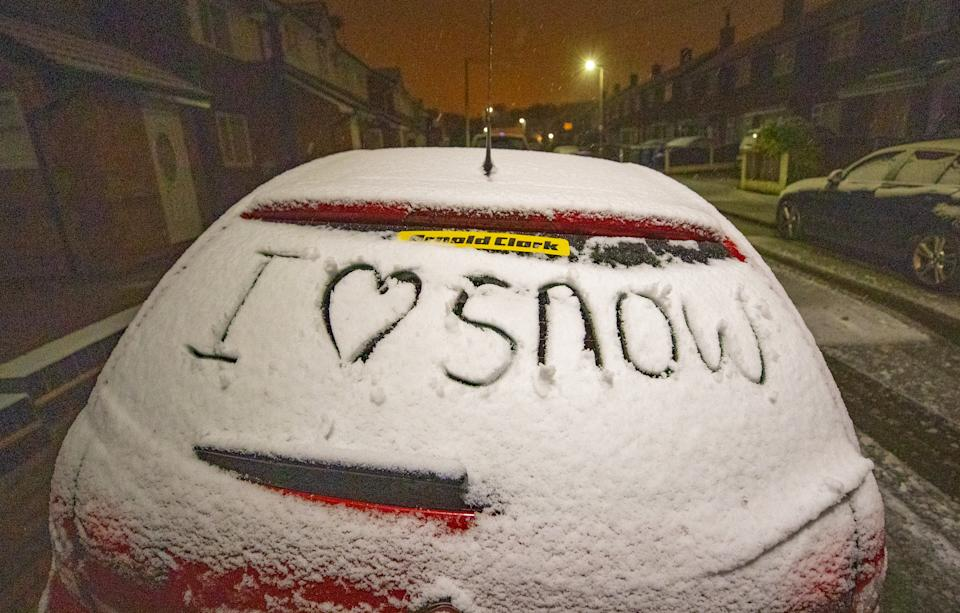 A message written on a car window after a snowfall in Liverpool overnight. (Photo by Peter Byrne/PA Images via Getty Images)