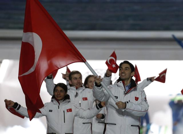 Turkey's flag-bearer Alper Ucar leads his country's contingent during the opening ceremony of the 2014 Sochi Winter Olympics, February 7, 2014. REUTERS/Phil Noble (RUSSIA - Tags: OLYMPICS SPORT)