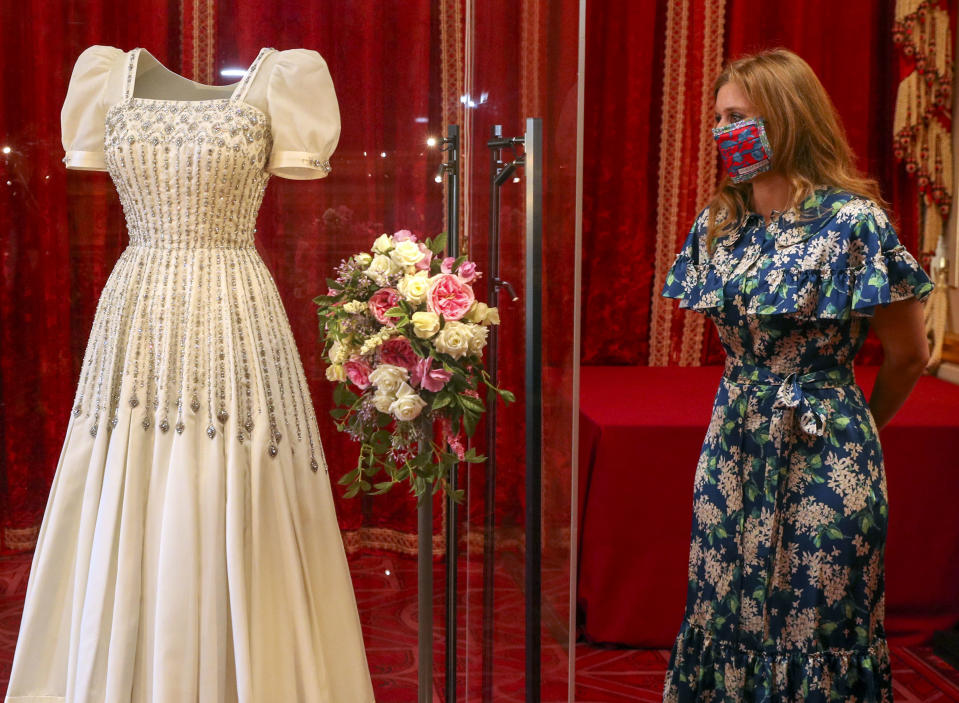 WINDSOR, ENGLAND - SEPTEMBER 23: Princess Beatrice poses alongside her wedding dress as it goes on display at Windsor Castle on September 23, 2020 in Windsor, England. Princess Beatrice and Edoardo Mapelli Mozzi married on July 18, 2020 in Windsor. (Photo by Steve Parsons - WPA Pool/Getty Images)