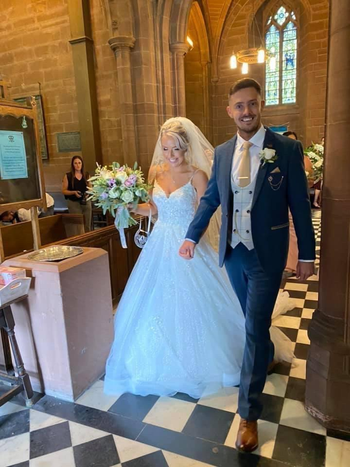 Lydia and Tidur Evans-Hughes finally married in front of family and friends at St Mary's Church in Eccleston, Cheshire (swns)