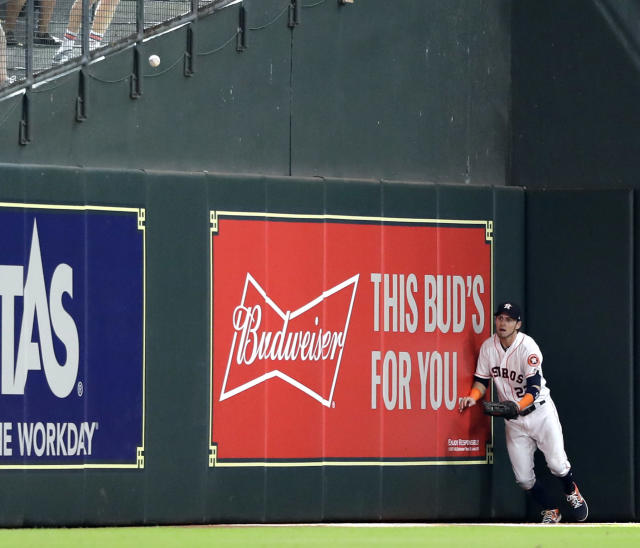 Houston Astros left fielder Josh Reddick chases a two-run double by Oakland Athletics' Mark Canha during the eighth inning of a baseball game Thursday, July 12, 2018, in Houston. (AP Photo/David J. Phillip)