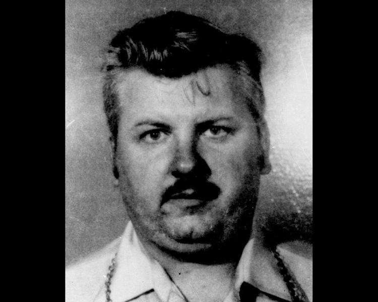 FILE - This 1978 file photo shows serial killer John Wayne Gacy. Cook County Sheriff Tom Dart says his officers and the FBI using high tech equipment and two dogs trained to sniff out human remains, went to the apartment complex of Gacy's late mother in march 2013 and found nothing to indicate the serial killer stashed any bodies there. Dart has been investigating the serial killer who was convicted in 1980 of murdering 33 young men in the 1970s on a number of fronts the last couple years, including the exhumation of bodies of unidentified Gacy victims in the hopes DNA testing could identify them. (AP Photo/File)