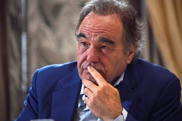 In this photo taken on Wednesday, June 19, 2019, and distributed by the Kremlin Press Service, US film director Oliver Stone gestures during his interview with Russian President Vladimir Putin for his Revealing Ukraine documentary, in the Kremlin, Moscow, Russia. (Alexei Druzhinin, Sputnik, Kremlin Pool Photo via AP)