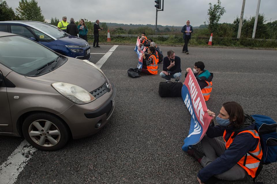 ESSEX, ENGLAND - SEPTEMBER 17:  Protesters from the Insulate Britain pressure group block a roundabout near Stansted Airport on September 17, 2021 in Stansted, Essex. (Photo by Guy Smallman/Getty Images)