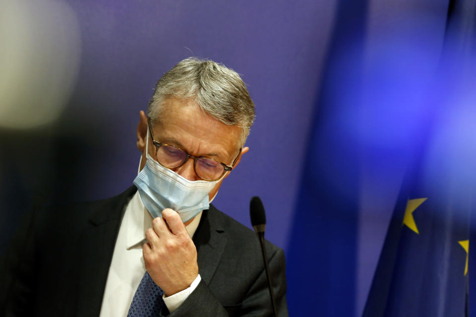 France's counterterrorism prosecutor, Jean-Francois Ricard, adjusts his mask as he gives a press conference at the Palais de Justice courthouse, in Paris, Tuesday, Sept. 29, 2020. France's counterterrorism prosecutor said the chief suspect in a double stabbing in Paris last week has identified himself as a 25-year-old man born in Pakistan and claimed he acted out of anger over caricatures of the Prophet Muhammad recently republished by satirical weekly Charlie Hebdo. (AP Photo/Thibault Camus)