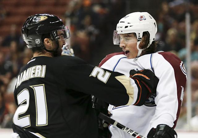 Anaheim Ducks right wing Kyle Palmieri, left, pushes Colorado Avalanche's Michell Heard during the second period of an NHL preseason hockey game in Anaheim, Calif., Sunday, Sept. 22, 2013. (AP Photo/Chris Carlson)