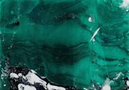 "It's hard to imagine icebergs as anything other than gigantic snow-white mini-islands floating around the coldest places on Earth. But for years, scientists have been baffled by the occasional ""emerald iceberg."" And while the color may seem odd, glaciologist <strong>Stephen Warren</strong> of the University of Washington has climbed up one of the frozen wonders to get a closer look. ""What is most amazing is not <a href=""https://www.iflscience.com/environment/mystery-ofrare-emerald-icebergs-spotted-in-antarctica-may-be-solved/"" rel=""nofollow noopener"" target=""_blank"" data-ylk=""slk:their color but rather their clarity"" class=""link rapid-noclick-resp"">their color but rather their clarity</a>, because they have no bubbles,"" he told <em>IFL Science</em><em>.</em> ""Ordinary icebergs originate as snow; as the snow is compressed under its own weight into ice, the air in the snow is closed off as bubbles. So glacier ice contains numerous bubbles, and icebergs are bright and cloudy."" After taking samples from the jade-colored iceberg, Warren found that the color was due to the fact that the icebergs were made of marine ice instead of glacial ice, and contained more iron oxide than typical ice."