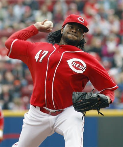 Cincinnati Reds starting pitcher Johnny Cueto throws against the Houston Astros during the first inning of a baseball game on Saturday, April 28, 2012, in Cincinnati. (AP Photo/David Kohl)