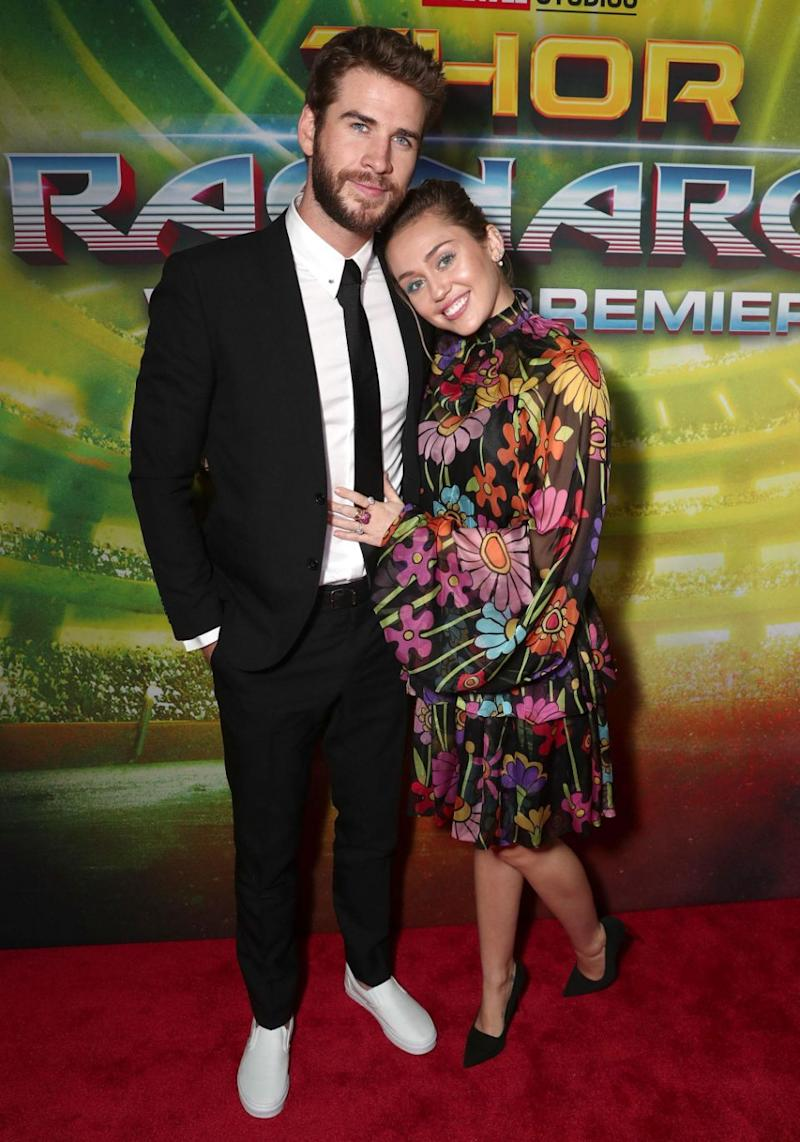 The pair cosied up on the red carpet as they posed for photos, arriving together to support Liam's older brother Chris who has a leading role in the flick. Source: Getty
