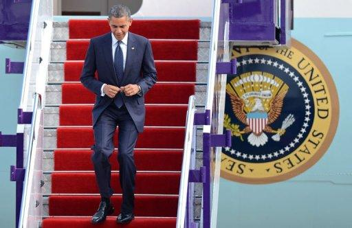 Barack Obama walks down the airplane stairs after his arrival at Don Mueang International airport in Bangkok