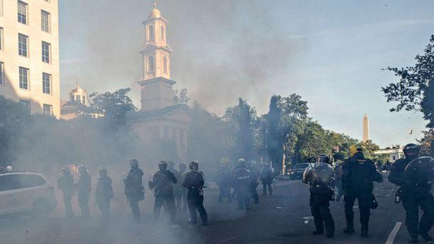 PHOTO: A line of police move demonstrators away from St. John's Church across Lafayette Park from the White House, June 1, 2020, in Washington. (Alex Brandon/AP)