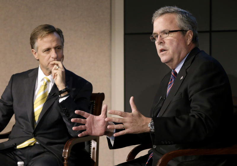 FILE - This Jan. 14, 2013 file photo shows former Florida Gov. Jeb Bush, right, and Tennessee Gov. Bill Haslam talking about education reform during a forum in Nashville, Tenn. More than five years after governors from both major parties began a mostly quiet effort to set new standards in American schools, the so-called Common Core initiative has morphed into a political tempest that fuels division among Republicans. Bush hails Common Core as a way to improve student performance and, over the long term, competitiveness of American workers. (AP Photo/Mark Humphrey, File)