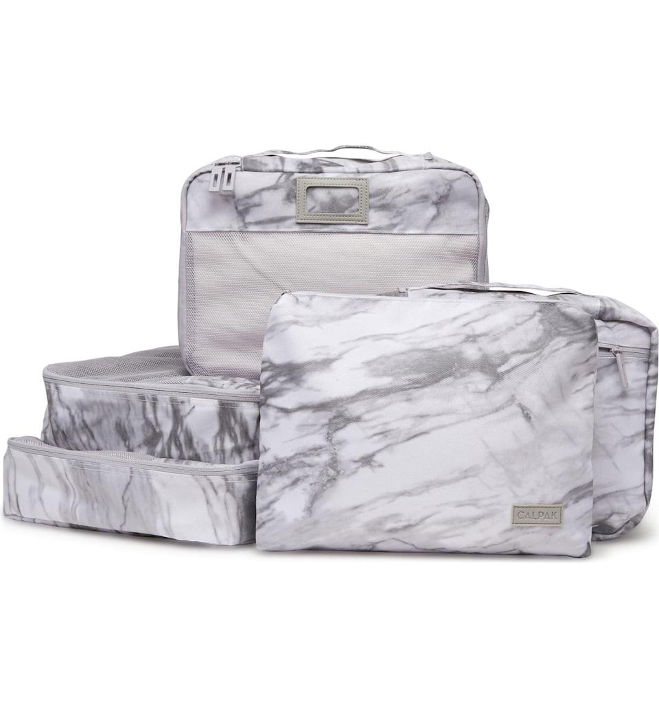 <p>Get this <span>Calpak 5-Piece Packing Cube Set</span> ($48) for your friend who loves to travel.</p>
