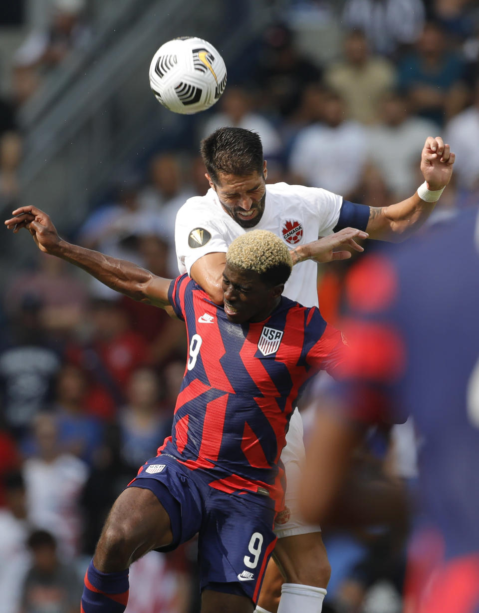 United States forward Gyasi Zardes (9) and Canada defender Steven Vitoria (5) go up for the ball during the first half of a CONCACAF Gold Cup soccer match in Kansas City, Kan., Sunday, July 18, 2021. (AP Photo/Colin E. Braley)