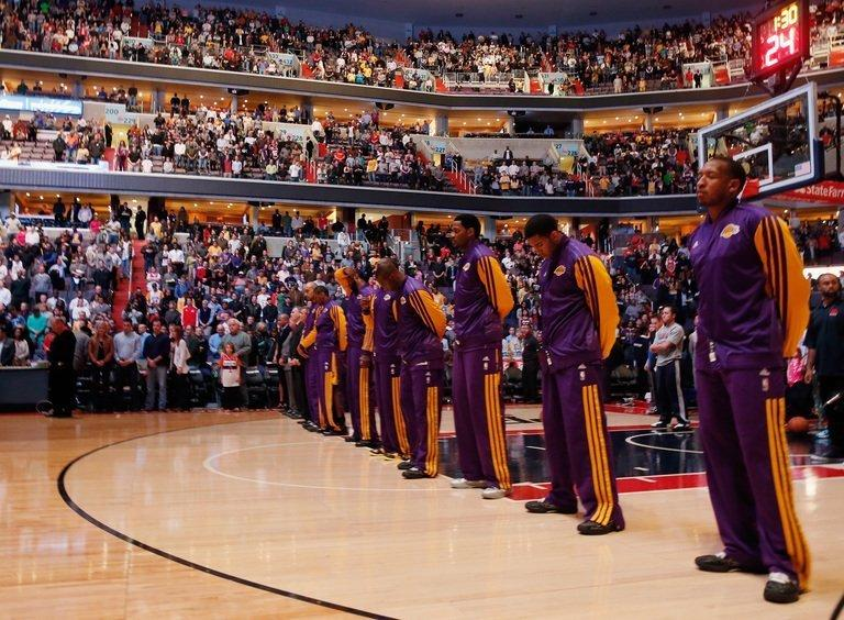 Los Angeles Lakers and the crowd observe a moment of silence for victims of the shooting in Newtown, December 14, 2012