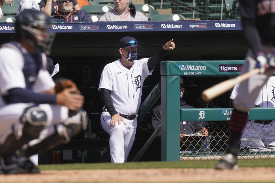 Detroit Tigers manager A.J. Hinch directs from the dugout during the second inning of a baseball game against the Cleveland Indians, Sunday, April 4, 2021, in Detroit. (AP Photo/Carlos Osorio)