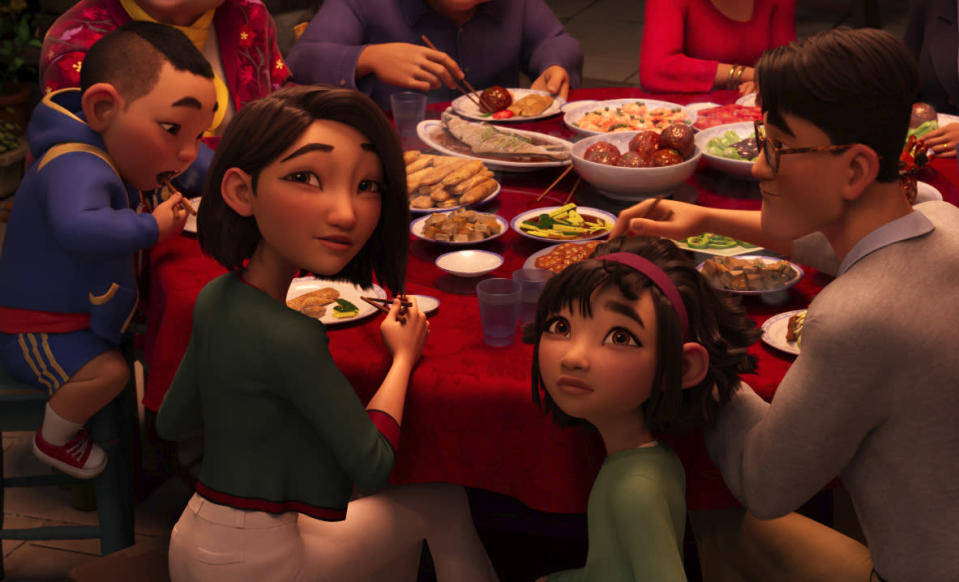 """This image released by Netflix shows animated characters, from left, Chin, voiced by Robert G. Chiu, Mrs. Zhong, voiced by Sandra Oh, Fei Fei, voiced by Cathy Ang and Father, voiced by John Cho in a scene from """"Over the Moon."""" (Netflix via AP)"""