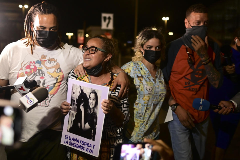 Keila Ortiz, the mother of Keishla Rodriguez, second from left, cries out for justice after boxer Felix Verdejo was arrested in connection with the death of her 27-year-old pregnant daughter whose body was found in a lagoon, outside FBI headquarters in San Juan, Puerto Rico, Sunday, May 2, 2021. (AP Photo/Carlos Giusti)