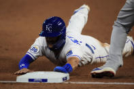 Kansas City Royals Whit Merrifield slides into third base during the sixth inning of a baseball game against the Chicago Cubs at Kauffman Stadium in Kansas City, Mo., Wednesday, Aug. 5, 2020. Merrifield advanced to third on a foul out by teammate Jorge Soler. (AP Photo/Orlin Wagner)