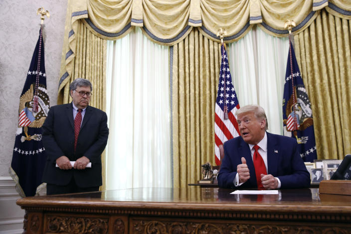 FILE - In this June 15, 2020, file photo President Donald Trump speaks alongside Attorney General William Barr during a law enforcement briefing on the MS-13 gang in the Oval Office of the White House in Washington. Barr is scheduled to appear for the first time before the House Judiciary Committee on Tuesday, July 28. (AP Photo/Patrick Semansky, File)