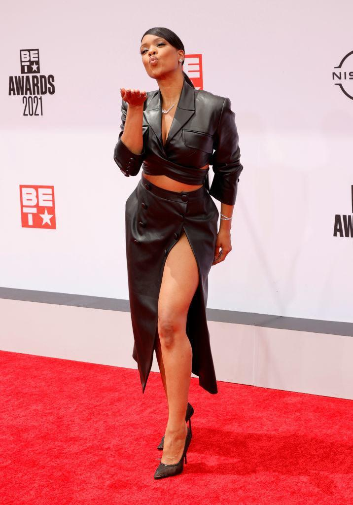 Michelle Mitchenor attends the BET Awards 2021 in a leather outfit