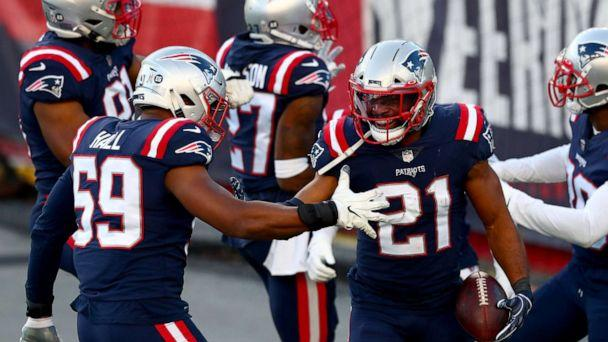 PHOTO: Adrian Phillips #21 celebrates with his teammates after intercepting a ball thrown during the game at Gillette Stadium, Nov. 29, 2020, in Foxborough, Massachusetts. (Adam Glanzman/Getty Images)