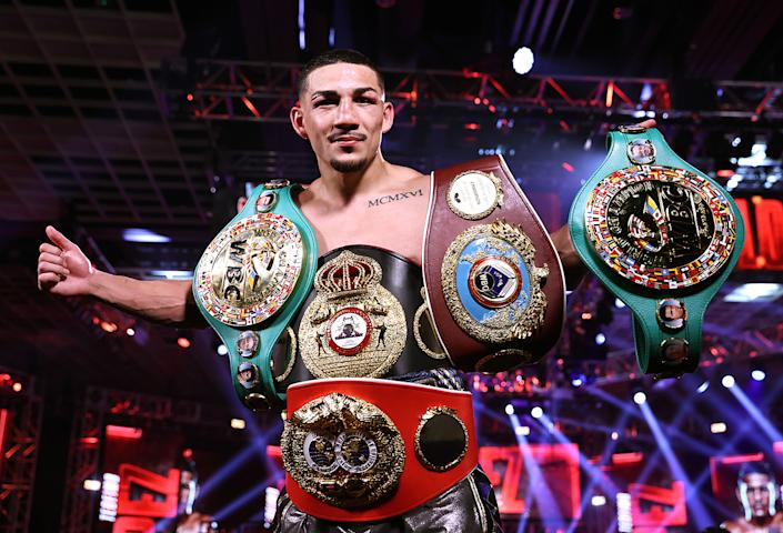 LAS VEGAS, NEVADA - OCTOBER 17: In this handout image provided by Top Rank, Teofimo Lopez Jr celebrates after defeating Vasiliy Lomachenko (not pictured) in their Lightweight World Title bout at MGM Grand Las Vegas Conference Center on October 17, 2020 in Las Vegas, Nevada. (Photo by Mikey Williams/Top Rank via Getty Images)