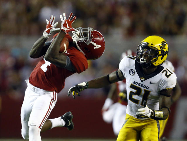 Alabama wide receiver Jerry Jeudy (4) catches a pass next to Missouri defensive back Christian Holmes (21) during the second half of an NCAA college football game Saturday, Oct. 13, 2018, in Tuscaloosa, Ala. Alabama won 39-10. (AP Photo/Butch Dill)