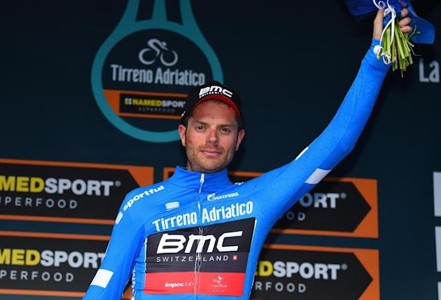 Overall leader Damiano Caruso, of Italy, celebrates on the podium after completing the 4th stage of the Tirreno-Adriatico cycling race, from Foligno to Sassotetto, Italy, Saturday, March 10, 2018. Mikel Landa won a thrilling sprint at the end of the fourth stage of the Tirreno-Adriatico race on Saturday, while Damiano Caruso moved into the overall lead after a mechanical failure for previous leader Geraint Thomas. (Dario Belingheri/ANSA via AP)