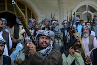 Afghan militia gather with their weapons to support Afghanistan security forces against the Taliban