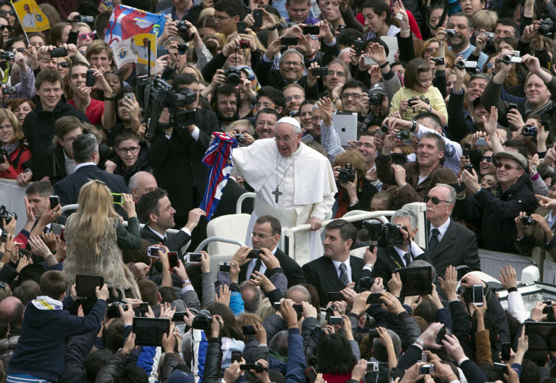 Pope Francis holds a San Lorenzo's soccer team jersey after celebrating his first Easter Mass in St. Peter's Square at the Vatican, Sunday, March 31, 2013. Pope Francis celebrated his first Easter Sunday Mass as pontiff in St. Peter's Square, packed by joyous pilgrims, tourists and Romans and bedecked by spring flowers.Wearing cream-colored vestments, Francis strode onto the esplanade in front of St. Peter's Basilica and took his place at an altar set up under a white canopy. (AP Photo/Alessandra Tarantino)