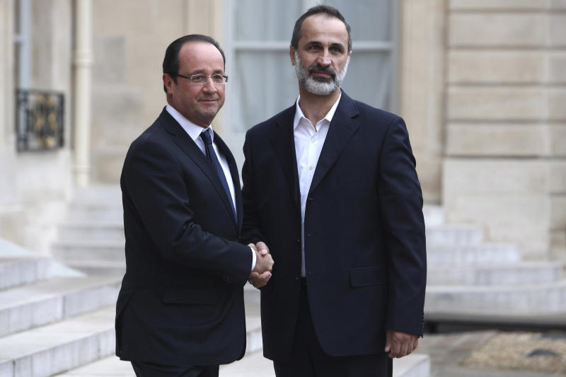 French President Francois Hollande, left, welcomes head of the new Syrian National Coalition for Opposition and Revolutionary Forces Mouaz al-Khatib, prior to a meeting, at the Elysee Palace, in Paris, Saturday, Nov. 17, 2012. France has taken a leading role among Western countries in supporting Syria's rebels. On Tuesday, it became the first Western nation to formally recognize Syria's newly formed opposition coalition as the sole legitimate representative of the Syrian people. (AP Photo/Thibault Camus)