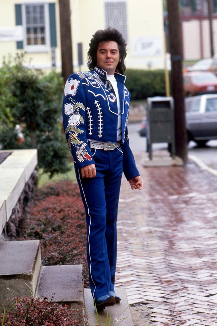 Hollywood designer Manuel counts MCA recording artist Marty Stuart among his clientele. Here Sept. 28, 1989, Stuart models his custom-designed electric blue suit at Manuel's 1922 Broadway store, which just opened for business in Nashville.