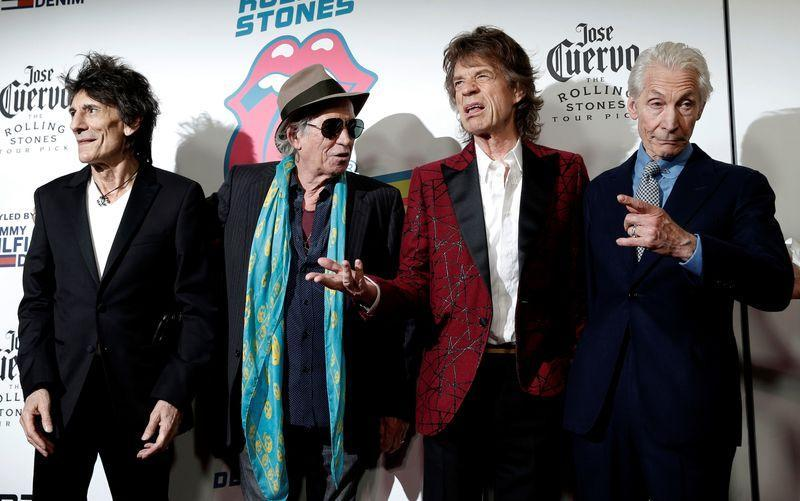"""The Rolling Stones (L-R) Ronnie Wood, Keith Richards, Mick Jagger and Charlie Watts pose as they arrive for the opening of the new exhibit """"Exhibitionism: The Rolling Stones"""" in the Manhattan borough of New York City"""