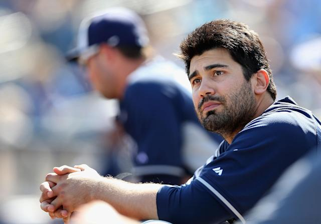 PHOENIX, AZ - MARCH 07: Carlos Quentin #18 of the San Diego Padres watches from the dugout during the spring training game against the Milwaukee Brewers at Maryvale Baseball Park on March 7, 2014 in Phoenix, Arizona. (Photo by Christian Petersen/Getty Images)
