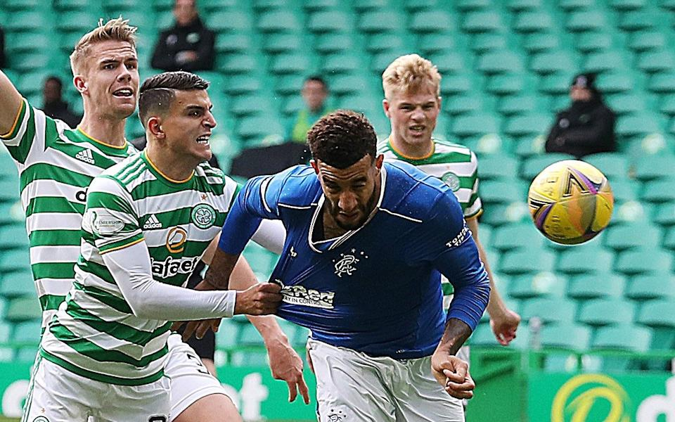 Conor Goldson scores the first of his two goals during Rangers 2-0 win over Celtic last weekend - GETTY IMAGES