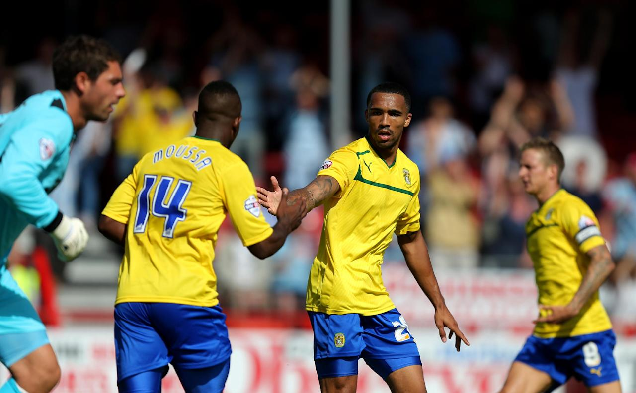 Coventry City's Callum Wilson (right) celebrates scoring their first goal of the game with teammate Franck Moussa during the Sky Bet League One match at Broadfield Stadium, Crawley.
