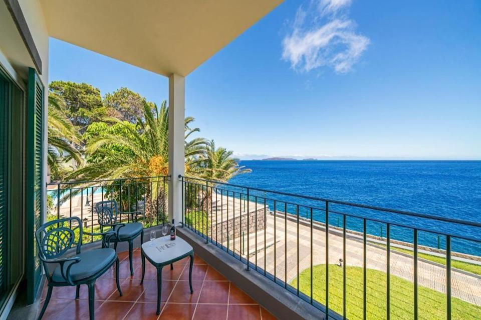 """<p>The main draw at this peaceful little hotel on Madeira's east coast is without a doubt its outdoor sea-water pools, carved out of the cliffside of its 450 yard stretch of private seafront. At <a href=""""https://go.redirectingat.com?id=127X1599956&url=https%3A%2F%2Fwww.booking.com%2Fhotel%2Fpt%2Festalagem-albatroz.en-gb.html%3Faid%3D1922306%26label%3Dmadeira-hotels&sref=https%3A%2F%2Fwww.goodhousekeeping.com%2Fuk%2Flifestyle%2Ftravel%2Fg37065833%2Fmadeira-hotels%2F"""" rel=""""nofollow noopener"""" target=""""_blank"""" data-ylk=""""slk:Albatroz Beach and Yacht Club"""" class=""""link rapid-noclick-resp"""">Albatroz Beach and Yacht Club</a>, there's also a third, heated pool at the hotel level, as well as a spacious sun terrace, smart lawns and grass tennis court.</p><p>The grown-up atmosphere continues inside, where you'll find a library, spa and sauna, and light-filled rooms with floor-to-ceiling windows and balconies, plus marble bathrooms stocked with Molton Brown toiletries. If you fancy eating in, Restaurant Hibiscus offers an a la carte menu at lunch and dinner with an extensive wine list, or head over to Funchal for Portuguese fine dining at the hotel's sister restaurants Casa Velha and the Dona Amélia.</p><p><a class=""""link rapid-noclick-resp"""" href=""""https://go.redirectingat.com?id=127X1599956&url=https%3A%2F%2Fwww.booking.com%2Fhotel%2Fpt%2Festalagem-albatroz.en-gb.html%3Faid%3D1922306%26label%3Dmadeira-hotels&sref=https%3A%2F%2Fwww.goodhousekeeping.com%2Fuk%2Flifestyle%2Ftravel%2Fg37065833%2Fmadeira-hotels%2F"""" rel=""""nofollow noopener"""" target=""""_blank"""" data-ylk=""""slk:CHECK AVAILABILITY"""">CHECK AVAILABILITY</a></p>"""