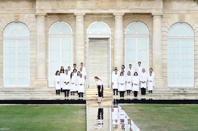 <p>Clare Waight Keller bows at the end of her Givenchy fall 2018 couture show with her atelier team. (Photo: Getty Images) </p>