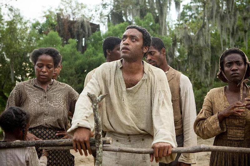 "This image released by Fox Searchlight shows Chiwetel Ejiofor, center, in a scene from ""12 Years A Slave."" The Golden Globes nominations will be announced on Thursday, Dec. 12. Ejiofor was nominated for a Golden Globe for best actor in a motion picture drama for his role in the film on Thursday, Dec. 12, 2013. The 71st annual Golden Globes will air on Sunday, Jan. 12. (AP Photo/Fox Searchlight, Jaap Buitendijk)"