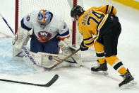 New York Islanders goaltender Semyon Varlamov (40) makes a pad-save on a shot by Boston Bruins left wing Jake DeBrusk (74) in the first period of an NHL hockey game, Thursday, April 15, 2021, in Boston. (AP Photo/Elise Amendola)
