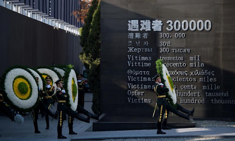 Soldiers of the People's Liberation Army attend a memorial ceremony at the Memorial Hall of the Victims in Nanjing Massacre, in Nanjing city on December 13, 2014 (AFP Photo/Johannes Eisele)