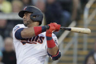 FILE - Minnesota Twins designated hitter Nelson Cruz (23) follows through on a single in the first inning of a spring training baseball game against the Pittsburgh Pirates in Fort Myers, Fla., in this Saturday, Feb. 29, 2020, file photo. Cruz is a free agent. (AP Photo/John Bazemore, File)