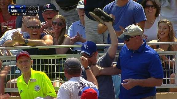 Royals fan makes incredible catch while tumbling backwards over row of seats (Video)