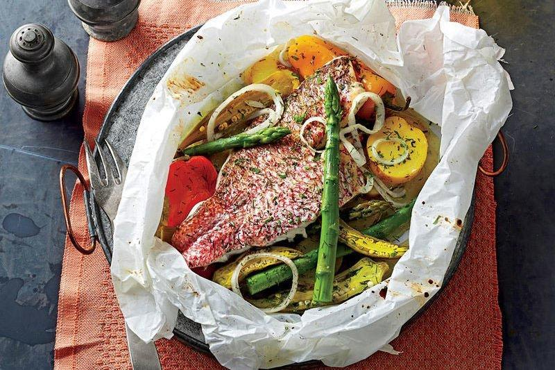 "<p><b>Recipe: <a href=""https://www.southernliving.com/syndication/snapper-baked-parchment-spring-vegetables"">Snapper Baked in Parchment with Spring Vegetables</a></b></p> <p>Each parcel of delicious snapper and fresh veggies steams with its own delicious juices, concentrating the flavors and releasing a mouthwatering aroma once opened.</p>"