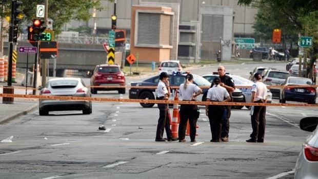 Montreal police established a perimeter near the intersection of Viger Avenue and Sanguinet Street on Wednesday evening after the collision. (Mathieu Wagner/Radio-Canada - image credit)