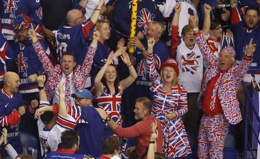 FILE - In this Saturday, May 11, 2019 file photo, fans of Great Britain celebrate after their team scored their first goal during the Ice Hockey World Championships group A match between Germany and Great Britain at the Steel Arena in Kosice, Slovakia. Ice hockey in Britain had been on a roll before the coronavirus. The Elite Ice Hockey League attendance was up. The national team broke into the top level of the world championship alongside the likes of Sweden, Russia and Canada. (AP Photo/Petr David Josek, File)