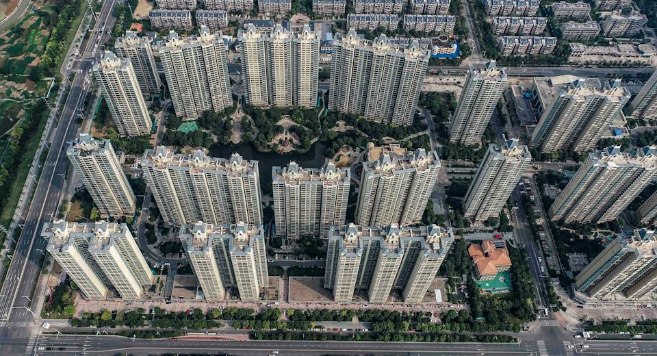 This aerial photo taken on September 17, 2021 shows a housing complex by Chinese property developer Evergrande in Huaian in China's eastern Jiangsu province. - China OUT (Photo by STR / AFP) / China OUT (Photo by STR/AFP via Getty Images)
